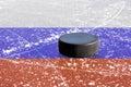 Black hockey puck on ice rink Royalty Free Stock Photo
