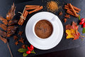 Black hot coffee in white cup with anis stars brown sugar and cinnamon sticks on stone board autumn theme Royalty Free Stock Images