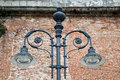 Black iron lamp by old brick wall a decorative street light an and mortar Royalty Free Stock Photos