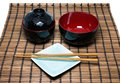 Black Japanese bowl and chopsticks Royalty Free Stock Photo