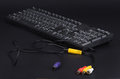 Black keyboard with cables isolated on the background Stock Photography