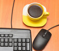 Black keyboard and coffee cup Royalty Free Stock Image