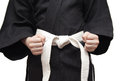 Black kimono and a white belt Royalty Free Stock Photos