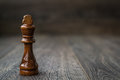 Black King, Chess Piece on a Wooden Table Royalty Free Stock Photo