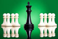 Black king in front of white pawns Stock Photography