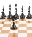 Black knight in front of black chess single Royalty Free Stock Photos