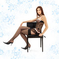 Black lace brunette in chair with mask Royalty Free Stock Images