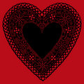 Black Lace Heart Doily on Red Background Stock Images