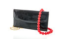 Black lack bag and red necklace elegant from beads Stock Photography