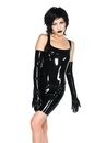 Black latex tall slender woman dressed in Stock Image