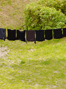 Black laundry hanging to dry on line outdoor Royalty Free Stock Photo