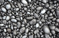 Black lava pebbles on beach Royalty Free Stock Photo