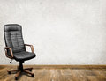 Black leather armchair in room business background Stock Images