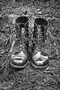 Black leather army boots on the cinders Stock Images
