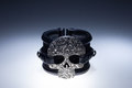 Black leather bracelet with metal skull pendant and black stones Royalty Free Stock Photo