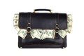 Black leather briefcase with dollars isolated on white backgroun Royalty Free Stock Photo
