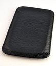 Black leather case for mobile phone view on a Stock Image