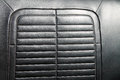 Black leather classic car seat detail Royalty Free Stock Photo