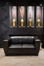 Black leather couch in anteroom Royalty Free Stock Photo
