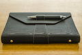 black leather organizer with pen Royalty Free Stock Photo