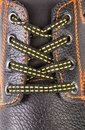 Black leather shoe laces in close-up. Royalty Free Stock Photo
