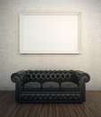 Black leather sofa next to white wall with blank frame Royalty Free Stock Photos
