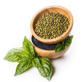 Black lentils and mash with basil in wooden bowls Stock Photography