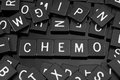 Black letter tiles spelling the word & x22;chemo& x22;