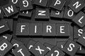 Black letter tiles spelling the word & x22;fire& x22;