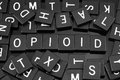 Black letter tiles spelling the word & x22;opioid& x22; Royalty Free Stock Photo