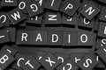 Black letter tiles spelling the word & x22;radio& x22;