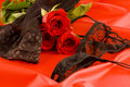Black lingerie and red roses Royalty Free Stock Photos