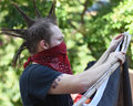 Black lives matter protest a white male protester wearing a bandana marches at the in charleston south carolina july Stock Photos