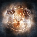 Black magic ritual two hooded figures and a demonic ram skull materialising within a fiery pentagram of mysterious occult symbols Stock Photography
