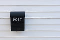 Black mail box on white wooden wall of house Royalty Free Stock Photo