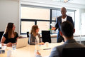 Black male executive leading meeting in conference room Royalty Free Stock Photo