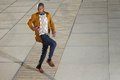 Black male fashion model posing outdoors in casual clothes portrait of a Royalty Free Stock Photo