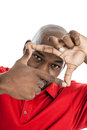 Black man getting perspective handsome in his s with his fingers isolated on white Royalty Free Stock Photography