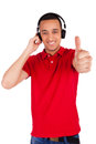 Black man having fun listening to music isolated over a white background Stock Images