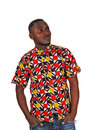 Black man looking up a handsome young in a colorful shirt and his hands in his pocket for white background Royalty Free Stock Photo