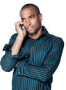 Black man with mobile phone Stock Photography