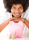 Black man with a piggybank Stock Photo