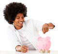 Black man saving money Royalty Free Stock Image