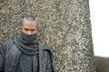 Black man with scarf covering face outdoors portrait of a Stock Photo