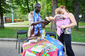 Black man shows drum caucasian baby moscow august and her mother at international festival of cultures in sokolniki park on august Stock Photos