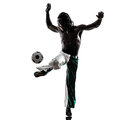 Black man soccer player juggling football silhouet one on white background Stock Photography