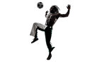 Black man soccer player juggling football silhouette one on white background Royalty Free Stock Photography