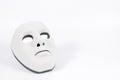 Black mask hidden behind white, human behaviour Royalty Free Stock Photo