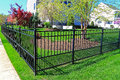 Black metal fence for family home back yard Stock Photo