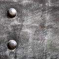 Black metal plate or armour texture with rivets grunge as background Royalty Free Stock Photography